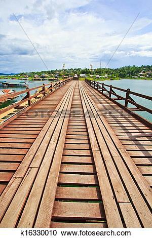 Stock Photography of The old wooden bridge Bridge across the river.