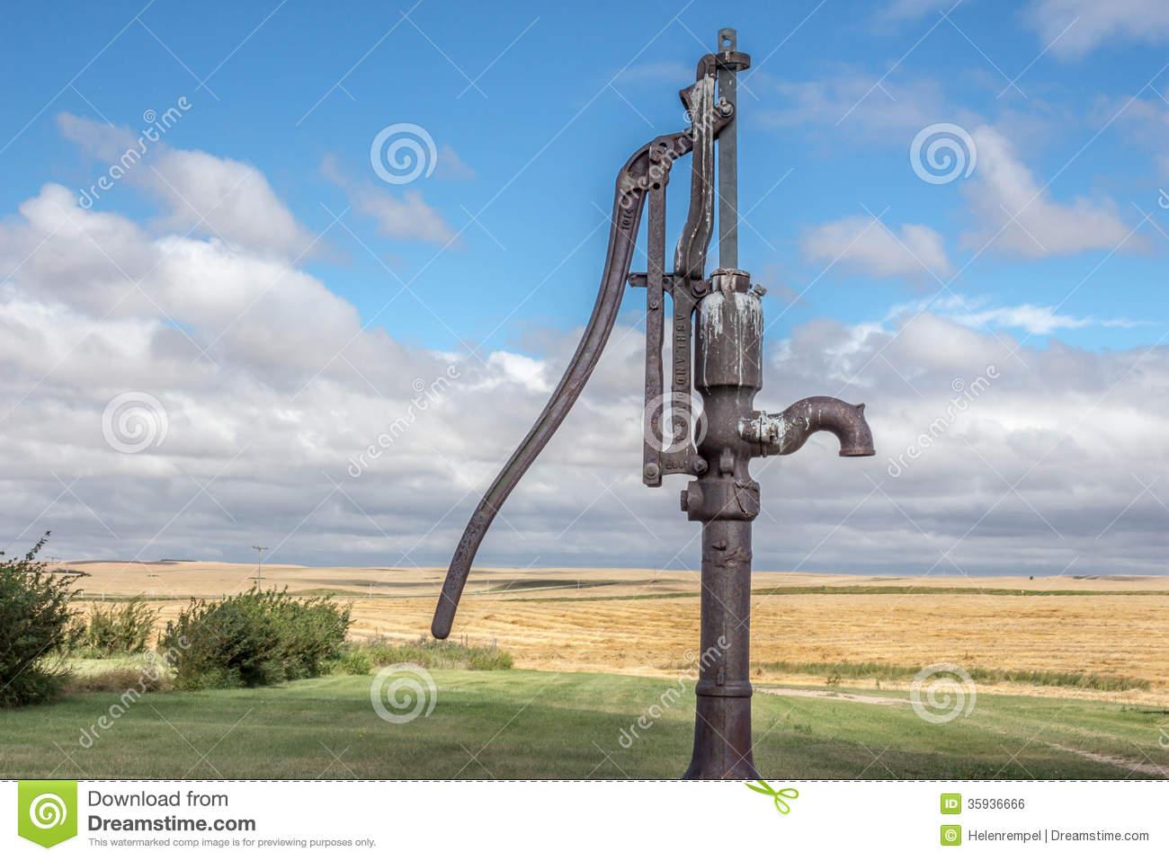 Antique Water Pump Stock Photo.