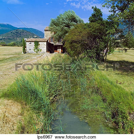 Picture of pr brook and renovated water driven olive mill house.