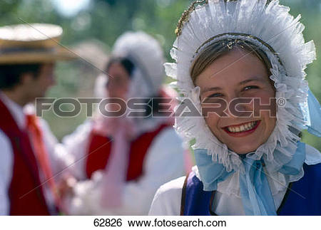 Stock Images of Portrait of young woman smiling in traditional.