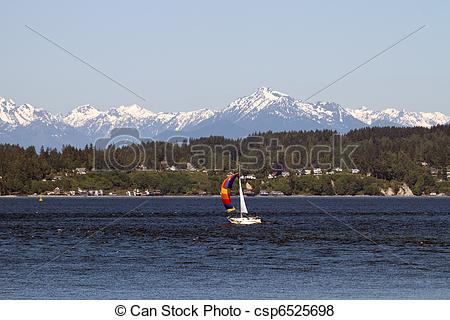 Pictures of Colorful Sailboat on Puget Sound Olympic Peninsula.