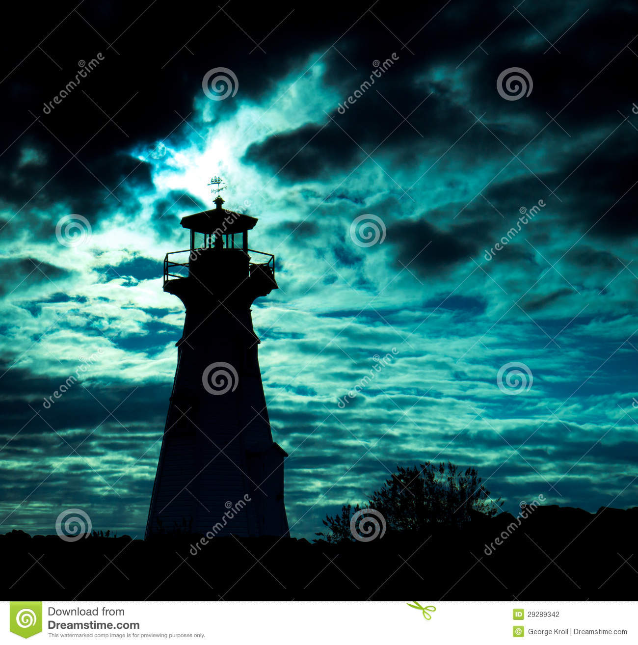 Lighthouse Silhouette Against Ominous Sky. Stock Photography.