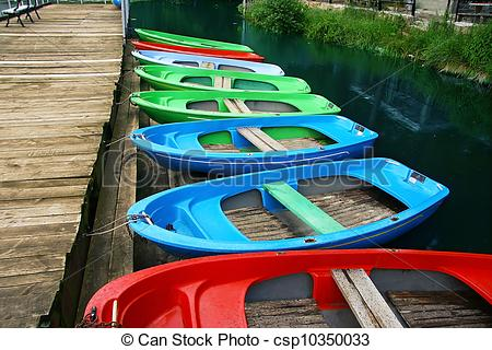Stock Photos of Colour boats at landing stage ashore.