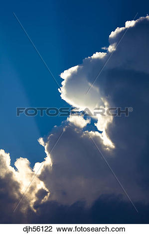 Stock Photo of Sky, Sunrays Shining through Cumulus Nimbus Clouds.