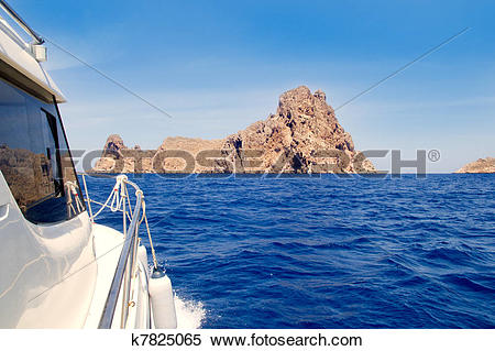 Stock Image of Ibiza yacht reaching Es Vedra island k7825065.
