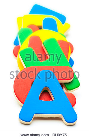Colored Wooden Letters, Stacked One Above The Other Stock Photo.