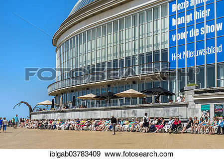 """Stock Photograph of """"People sunbathing in front of the Oostende."""