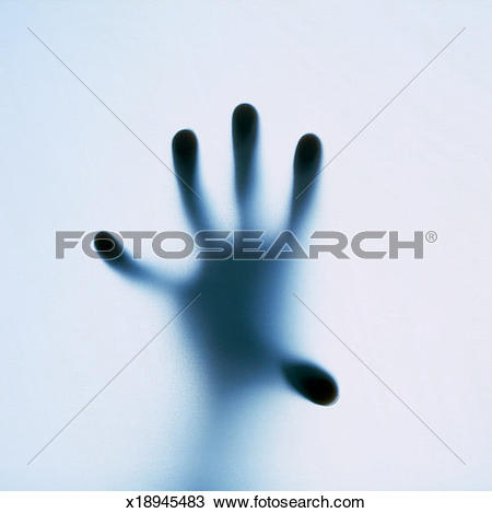 Stock Photo of Silhouette of a person's open palm seen through.