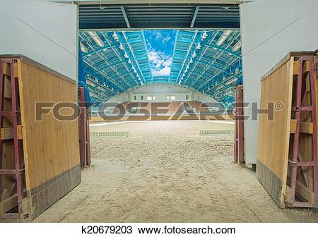 Stock Photo of Large horse arena interior with open sky k20679203.