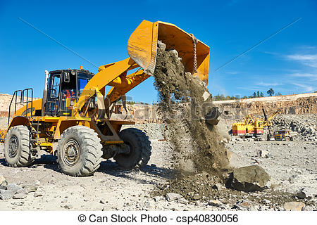 Stock Images of wheel loader excavator at granite or iron ore.