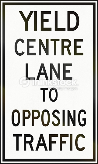 Yield Centre Lane To Opposing Traffic In Canada Stock Photo.