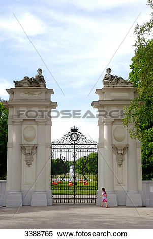 Stock Image of Girl in front of the gate to the palace garden of.