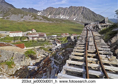Stock Photo of Old ore car tracks on a wooden trestle overlooking.