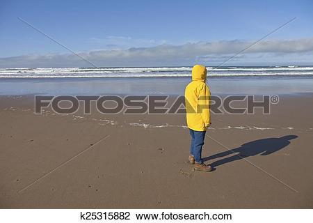 Clip Art of Taking a walk on the Oregon coast. k25315882.