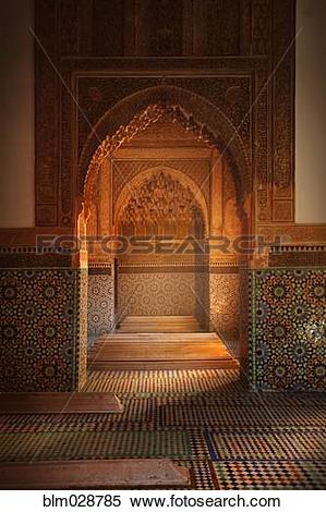 Stock Image of Ornate arches in tiled room, Marrakech, Morocco.