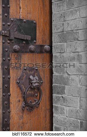 Stock Photo of Wooden Door With Ornate Door Knocker bld116572.