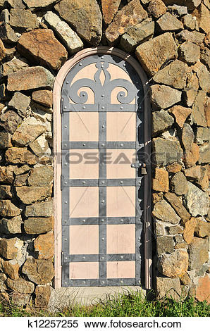 Stock Image of Ornate door on a guard house stone wall k12257255.