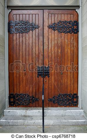 Pictures of Wood Church Doors with ornate hinges.