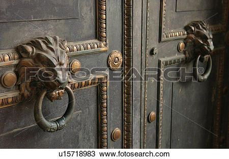 Stock Photo of Ornate door knockers on a door u15718983.