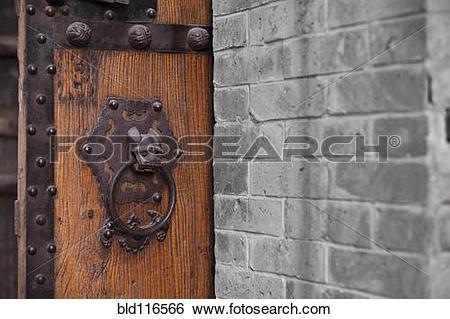 Stock Images of Wooden Door With Ornate Door Knocker bld116566.
