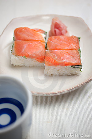 Salmon Oshizushi And Sake Stock Photos.
