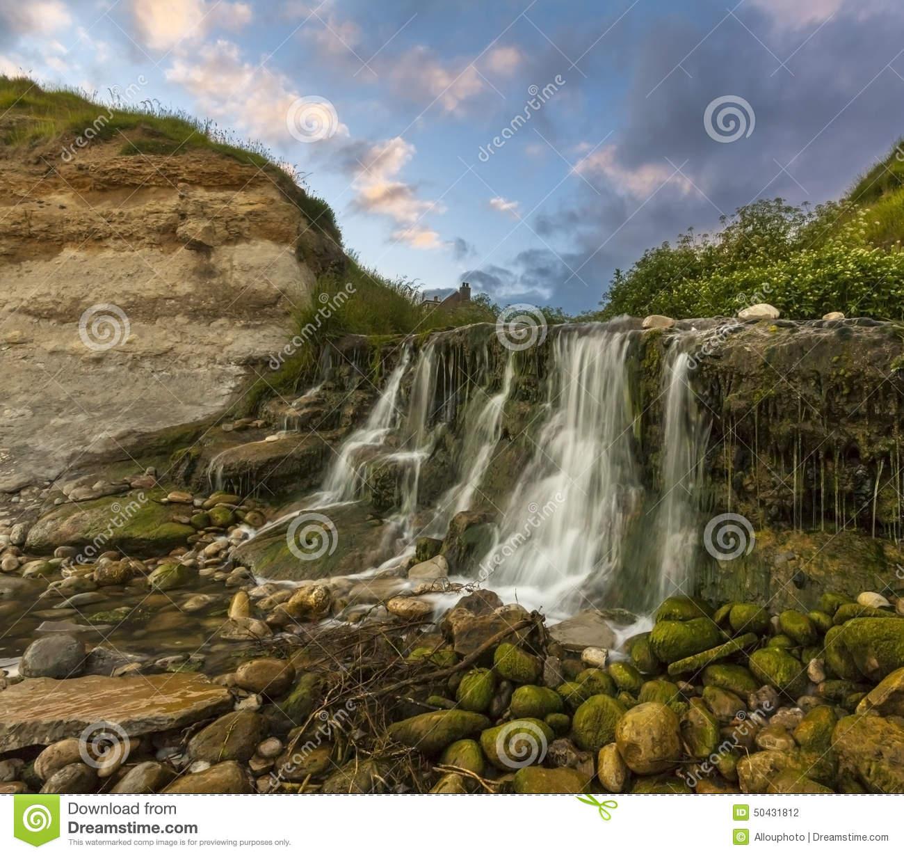 Waterfall At Osmington Mills In Dorset Stock Photo.