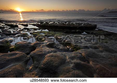 Stock Photo of England, Dorset, Osmington Mills. Sunrise over.