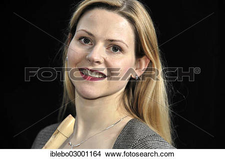 """Stock Photo of """"Young woman holding a flute or recorder."""