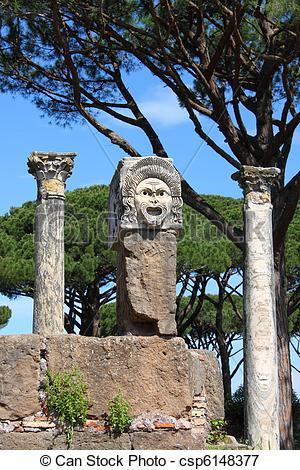 Picture of Satiric mask in Ostia Antica, the old Harbour of Rome.