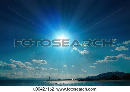 Stock Photo of Blue sun over Biwa Lake. Otsu, Shiga Prefecture.