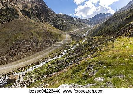Stock Photography of Hiking path along a glacial stream.