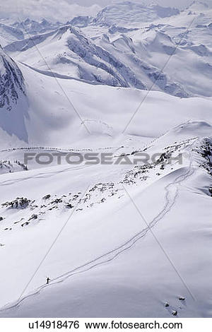 Stock Images of Skier hikes out of bounds, Whistler Mtn. BC.