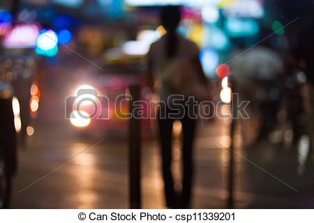 Stock Photography of Out Of Focus Street Prostitute Headlights.