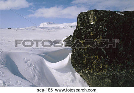 Stock Image of Rock Outcrop in Snowy Landscape Finse Norway sca.