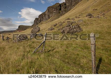 Stock Photograph of Pastureland on scree mountainside with rock.
