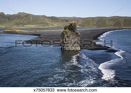 Stock Photo of Large rock outcropping in ocean waves x75057833.