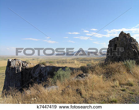 Stock Photograph of Rock outcropping with dry grass and Utah.