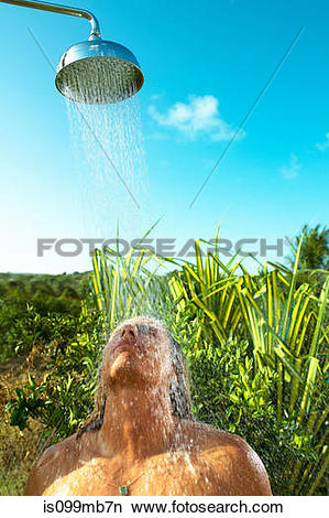 Stock Photo of Man enjoying cool shower outdoors is099mb7n.