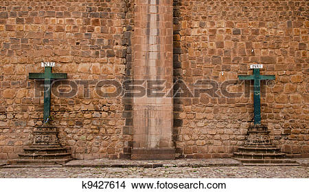 Stock Photo of Two crosses at the outer wall of the Cathedral in.