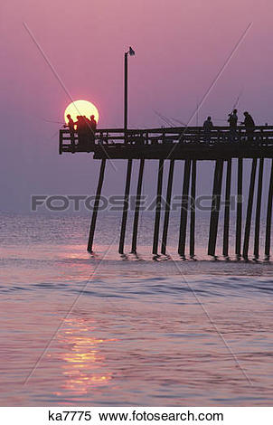 Stock Image of sunrise at outer banks fishing pier bodie island.