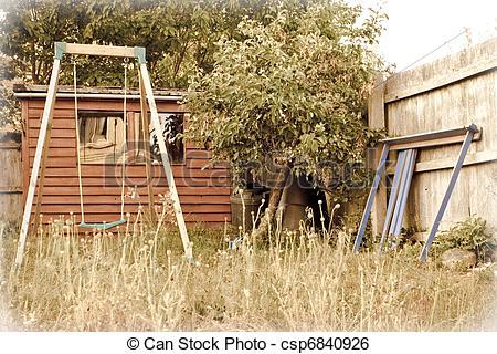 Picture of overgrown garden swing.