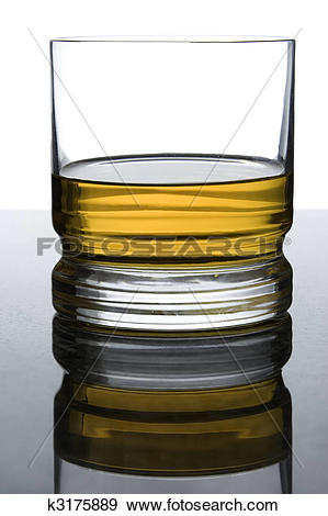Stock Photograph of whisky on black granite with overexposed.