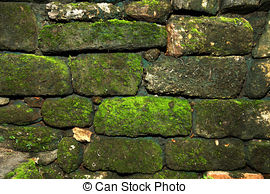 Stock Photo of Old stone wall overgrown with moss csp26848122.