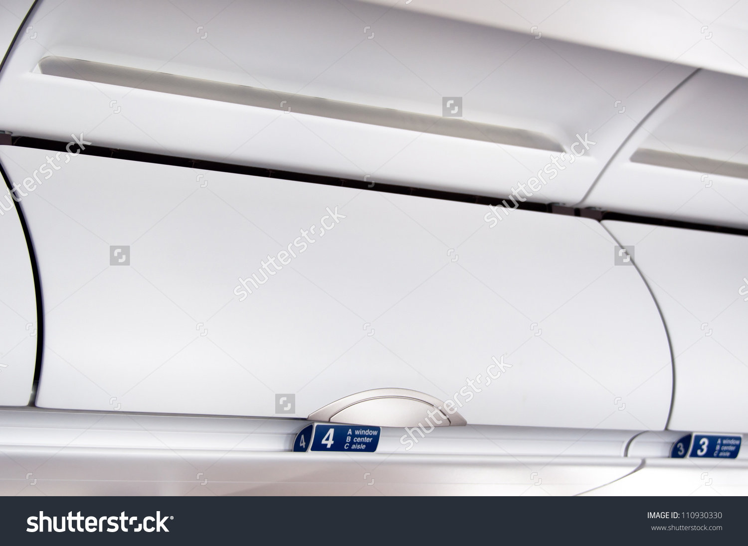 Overhead Compartment Detail Shot Airplane Cabin Stock Photo.