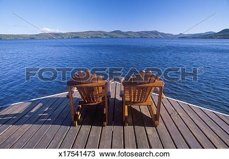 Stock Photo of 'Two Adirondack chairs on a deck overlooking Lake.