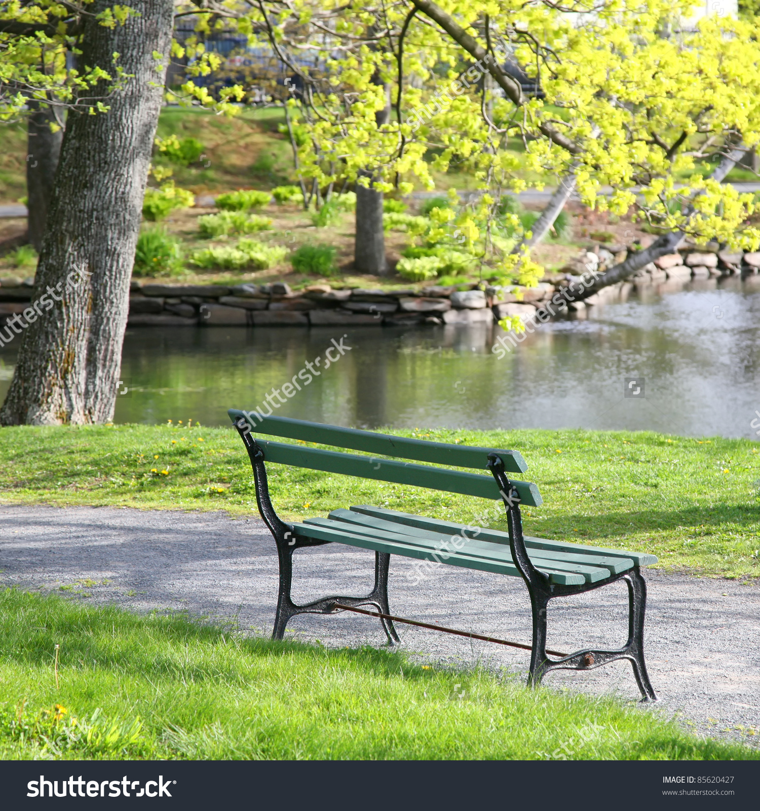 Empty Wooden Park Bench Overlooking Lake Stock Photo 85620427.