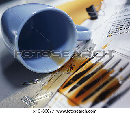 Picture of Overturned coffee cup; coffee spilled over papers and.