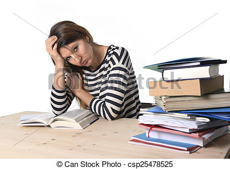 Stock Photo of young stressed student girl studying and preparing.