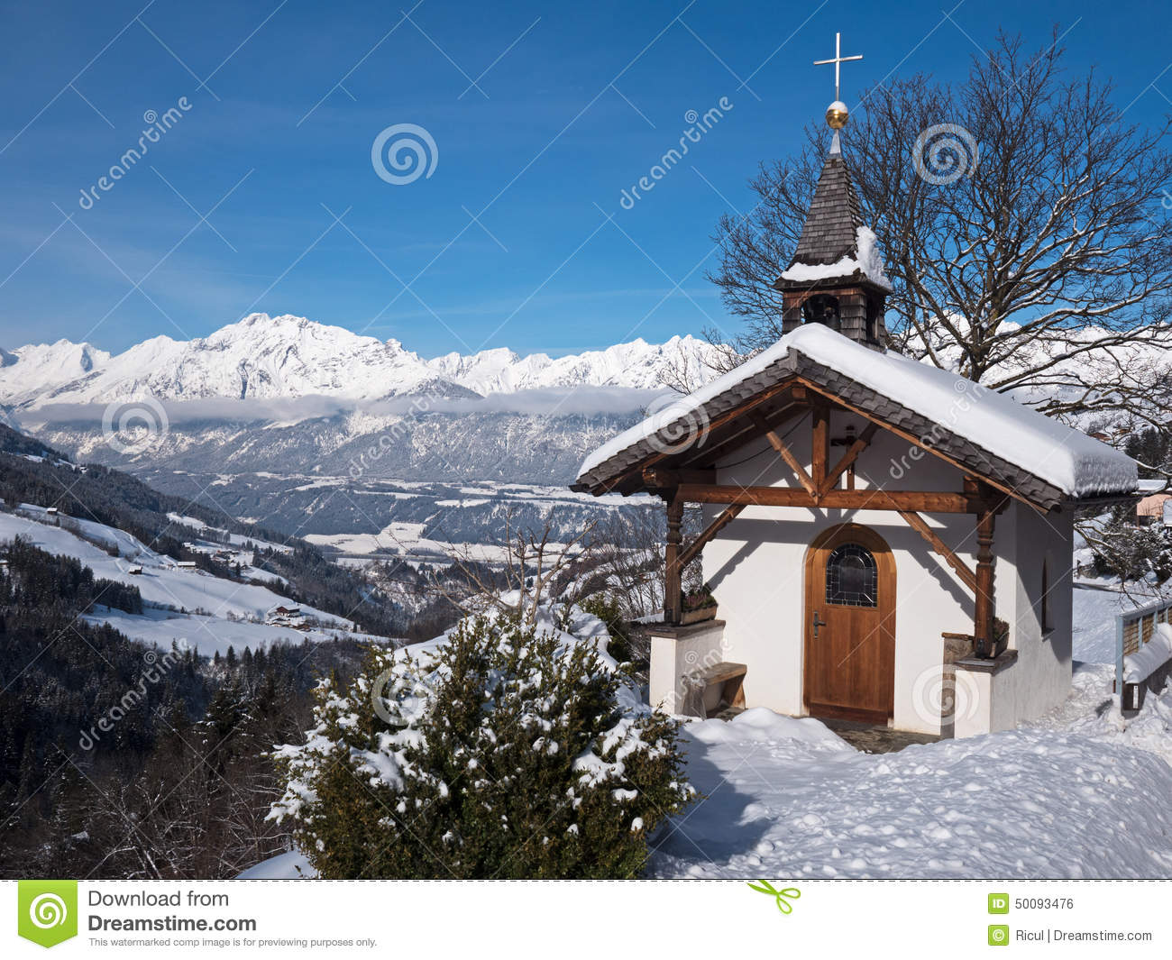Mountain Chapel In The Alps Stock Photo.
