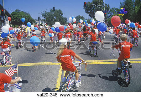 Stock Images of Children Riding Bicycles in July 4th Parade.